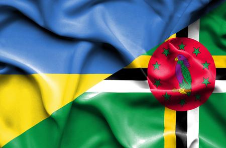 dominica: Waving flag of Dominica and Ukraine Stock Photo