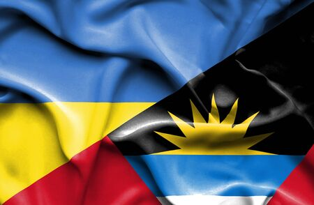 antigua: Waving flag of Antigua and Barbuda and Ukraine Stock Photo