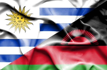 malawian: Waving flag of Malawi and Uruguay