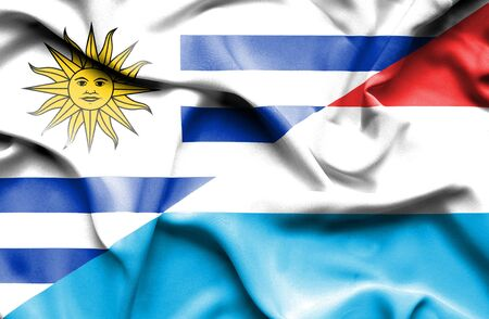 luxembourg: Waving flag of Luxembourg and Uruguay Stock Photo