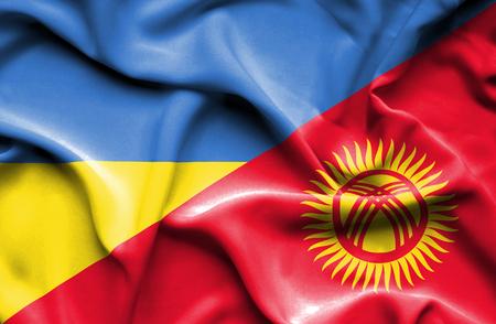 kyrgyzstan: Waving flag of Kyrgyzstan and Ukraine Stock Photo
