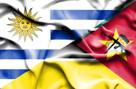 mozambique: Waving flag of Mozambique and Uruguay Stock Photo