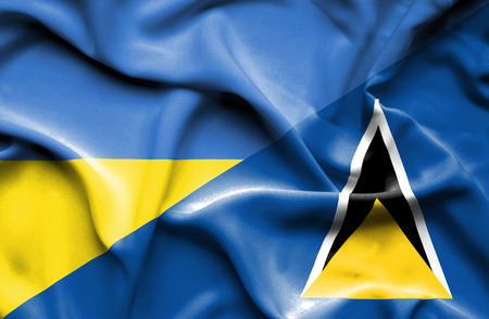st lucia: Waving flag of St Lucia and Ukraine Stock Photo