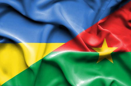 burkina faso: Waving flag of Burkina Faso and Ukraine