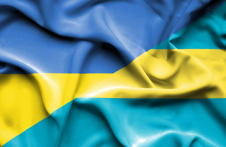 bahamas: Waving flag of Bahamas and Ukraine Stock Photo