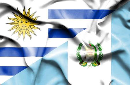 guatemalan: Waving flag of Guatemala and Uruguay Stock Photo