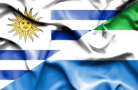 sierra leone: Waving flag of Sierra Leone and Uruguay Stock Photo