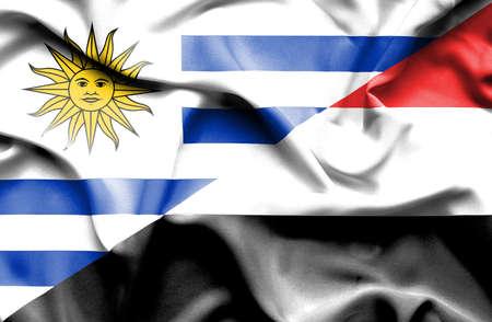 yemen: Waving flag of Yemen and Uruguay Stock Photo