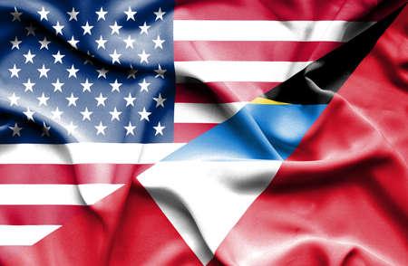 barbuda: Waving flag of Antigua and Barbuda and USA Stock Photo