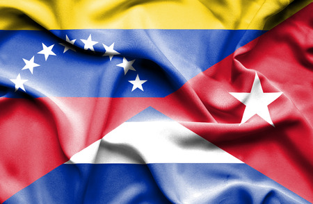 Waving flag of Cuba and Venezuela Stock Photo