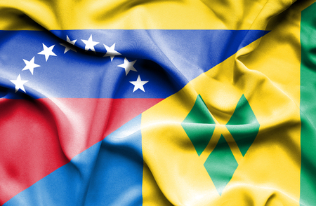 grenadines: Waving flag of Saint Vincent and Grenadines and Venezuela