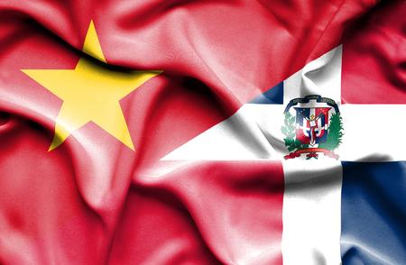 dominican republic: Waving flag of Dominican Republic and Vietnam Stock Photo
