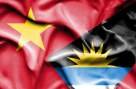 vietnam war: Waving flag of Antigua and Barbuda and Vietnam