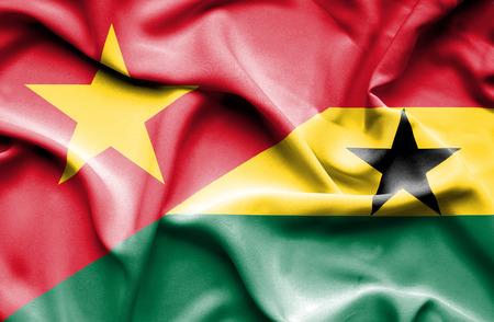 vietnam war: Waving flag of Ghana and Vietnam