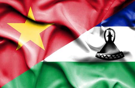 lesotho: Waving flag of Lesotho and Vietnam Stock Photo