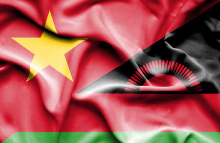 malawian flag: Waving flag of Malawi and Vietnam Stock Photo