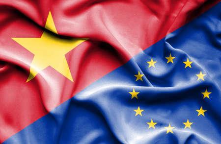 european union: Waving flag of European Union and Vietnam