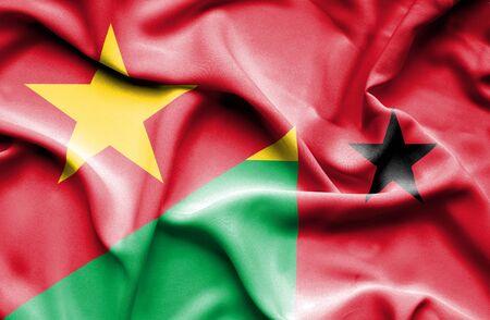 guinea bissau: Waving flag of Guinea Bissau and Vietnam Stock Photo
