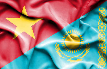 kazakhstan: Waving flag of Kazakhstan and Vietnam Stock Photo