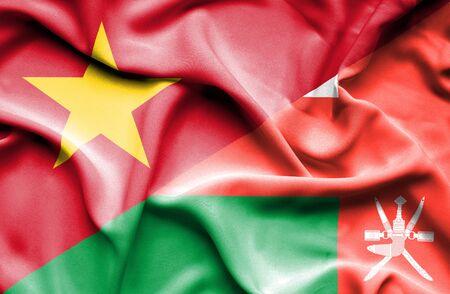 vietnam war: Waving flag of Oman and Vietnam