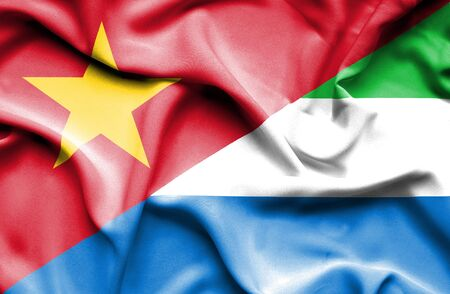 sierra leone: Waving flag of Sierra Leone and Vietnam Stock Photo