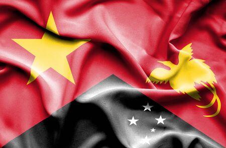 vietnam war: Waving flag of Papua New Guinea and Vietnam