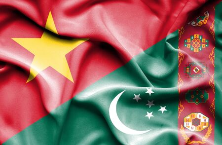 turkmenistan: Waving flag of Turkmenistan and Vietnam Stock Photo