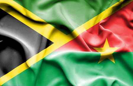 burkina faso: Waving flag of Burkina Faso and Jamaica