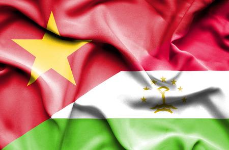 tajikistan: Waving flag of Tajikistan and Vietnam Stock Photo