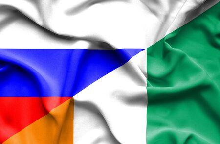 ivory: Waving flag of Ivory Coast and Russia