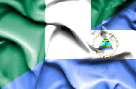 nicaragua: Waving flag of Nicaragua and Nigeria Stock Photo