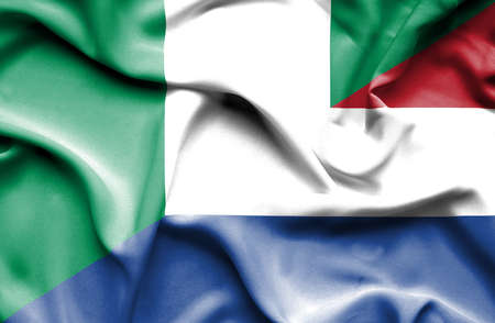 dutch culture: Waving flag of Netherlands and Nigeria