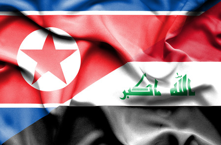 iraq conflict: Waving flag of Iraq and North Korea