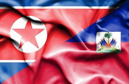 haiti: Waving flag of Haiti and North Korea Stock Photo