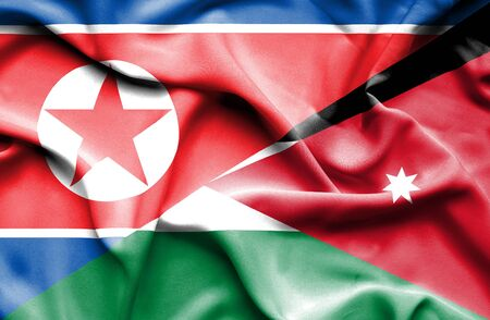 north korea: Waving flag of Jordan and North Korea Stock Photo