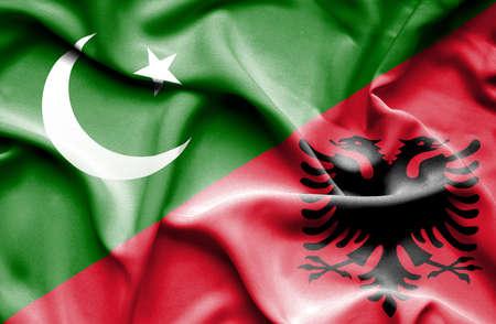 flag of pakistan: Waving flag of Albania and Pakistan Stock Photo
