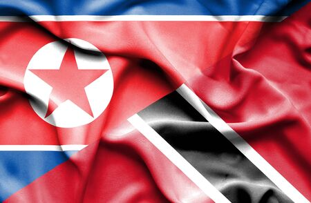 trinidad and tobago: Waving flag of Trinidad and Tobago and North Korea