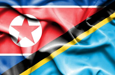 north korea: Waving flag of Tanzania and North Korea Stock Photo
