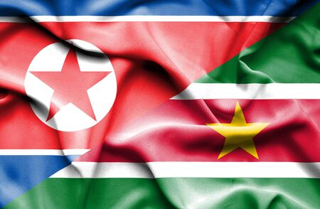 north korea: Waving flag of Suriname and North Korea Stock Photo