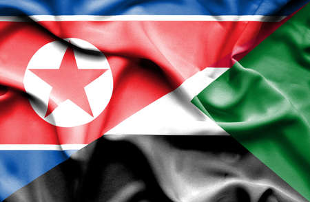 north korea: Waving flag of Sudan and North Korea Stock Photo