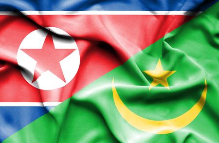 mauritania: Waving flag of Mauritania and North Korea Stock Photo