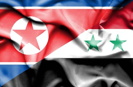 north korea: Waving flag of Syria and North Korea