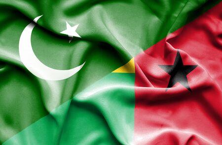 guinea bissau: Waving flag of Guinea Bissau and Pakistan