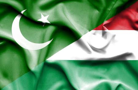 flag of pakistan: Waving flag of Hungary and Pakistan Stock Photo