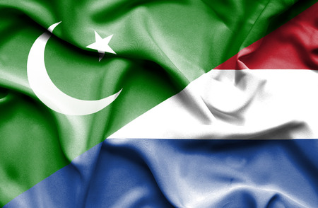 dutch culture: Waving flag of Netherlands and Pakistan