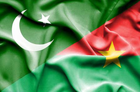 burkina faso: Waving flag of Burkina Faso and Pakistan