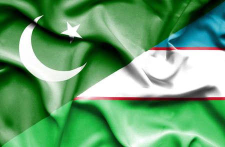 uzbekistan: Waving flag of Uzbekistan and Pakistan Stock Photo
