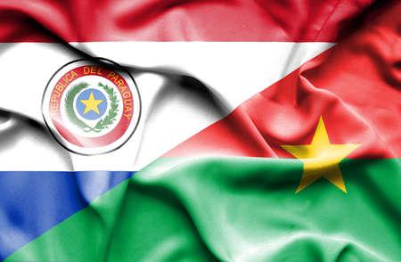 burkina faso: Waving flag of Burkina Faso and Paraguay