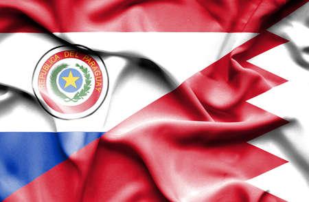 bahrain money: Waving flag of Bahrain and Paraguay Stock Photo