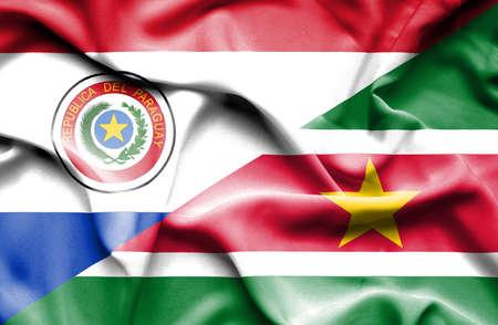suriname: Waving flag of Suriname and Paraguay